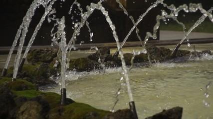 Fountain jets  on a rocky background