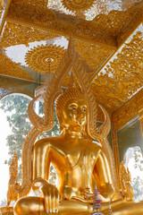 meditating golden buddha statue