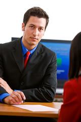 Business: Serious Man Terminating Employee