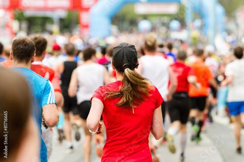 canvas print picture Frau beim Zieleinlauf Marathon