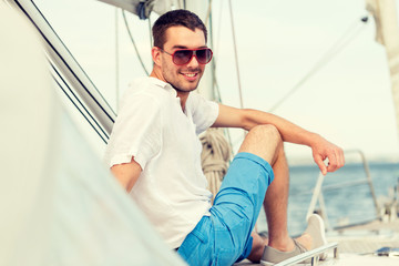 man sitting on yacht deck
