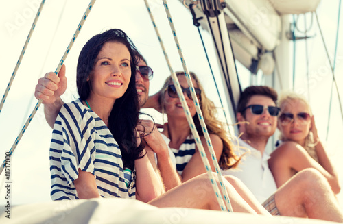 smiling friends sitting on yacht deck - 81717000