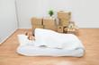 Young Couple Sleeping On Mattress - 81717206