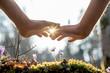 Leinwanddruck Bild - Hand Covering Flowers at the Garden with Sunlight