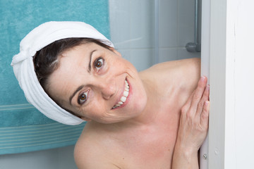 Portrait of shocked woman covering her body with towel