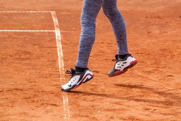 Girl serving on a tennis match