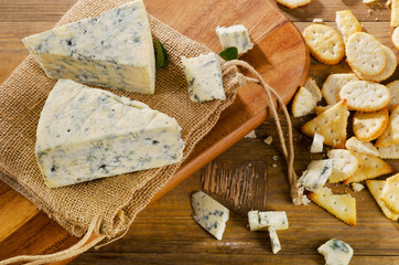 Blue cheese on  wooden table .