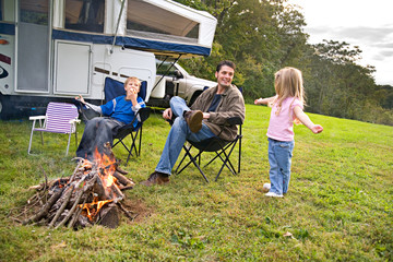 Camping: Dad Listens To Little Girl Tell a Story By The Fire