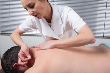 Man Undergoing Acupuncture Treatment