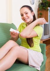 Girl applying gel over bruise