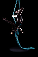 Young woman gymnast with blue gymnastic ribbon