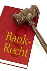 Richterhammer mit Buch und Bankrecht