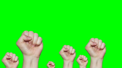 4k lot of fists raising up in front of green screen background