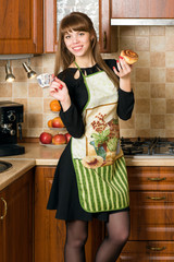 Young woman dressed in apron on the kitchen