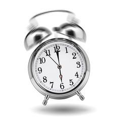 ringing classical alarm clock isolated on white background