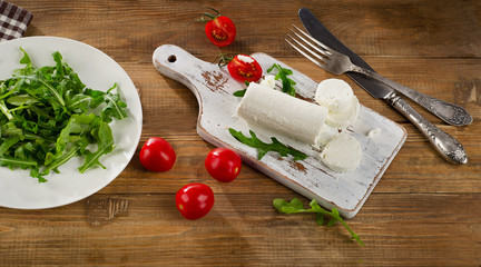 Goat cheese with fresh salad and tomatoes