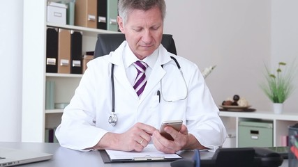 doctor working at the hospital and using a smart phone