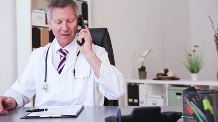 Medical doctor working with laptop in the office and write