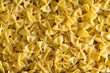 Full frame background of Italian bow tie pasta - 81721462