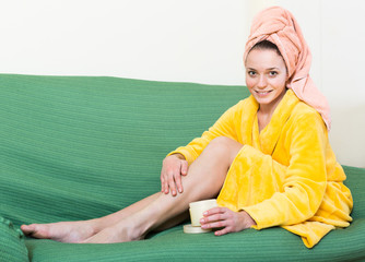 Housewife rubbing cream into skin
