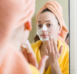 Woman taking care of face