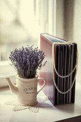 Book with a bouquet of heather