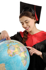 Beautiful graduate girl student in mantle with globe