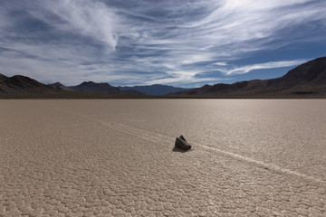 Sailing Stone on a cracked dry lake floor