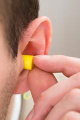 Yellow Earplug Into The Ear