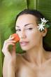 Beautiful woman having fresh papaya facial mask apply. fresh pap
