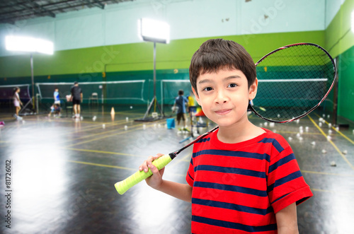 Little boy taking badminton racket in training class at the gym - 81726012