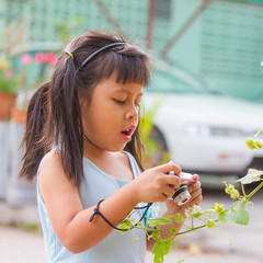 little asia girl taking photo and mouth open