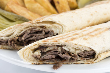 Close up of kebab wrap rolled with lavash bread.