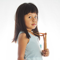 little girl with a slingshot on white