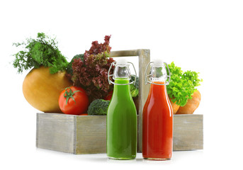 Glass bottles of fresh healthy juice with set of fruits and