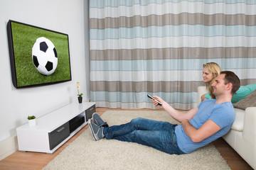 Couple Watching Football Match