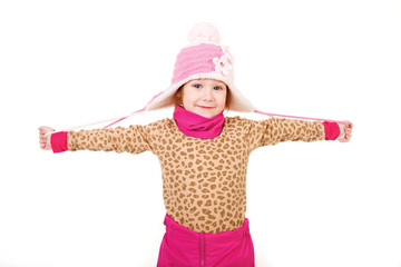 Little girl in a pink hat with arms outstretched