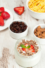 yogurt with strawberries and products for healthy breakfast