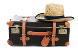 Fototapety Suitcase and straw hat isolated on white