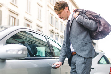 business man opening his car