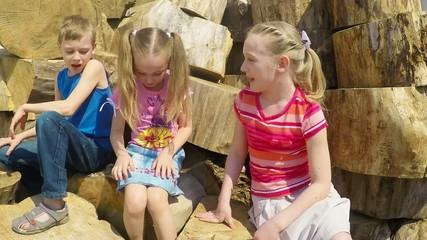 three children 7-10 years laugh and talk