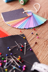 Samples of colorful fabric on wooden background