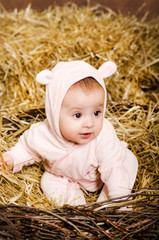 little girl. child in pink overalls with ears.