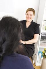 Customer consultation at body treatment clinic