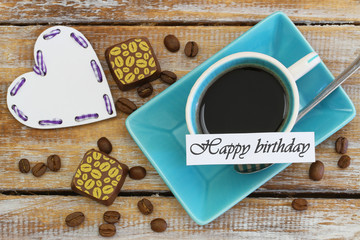 Happy Birthday card with cup of coffee, chocolates and heart