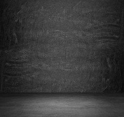Dark concrete empty room. The chalkboard on the whole wall.