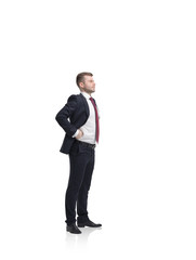 Standing young successful businessman. Isolated on white.