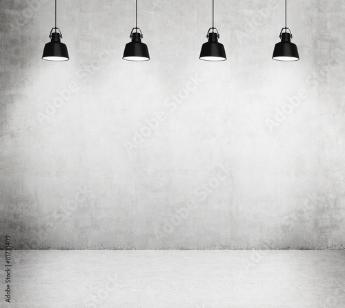 Concrete room with four black lamps. - 81731409