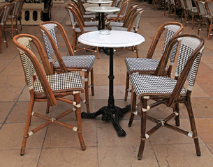 french outdoor cafe with small round tables and chairs