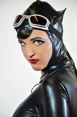 Sexy brunette in tight black cat costume